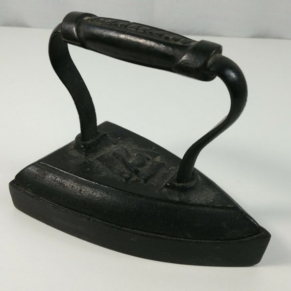 antique-number-7-w-shield-sad-iron-pat-1888-no-rust-doorstop-bookend-display
