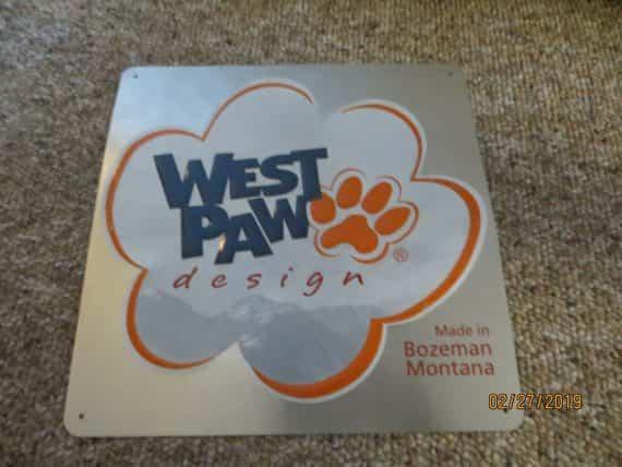 west-paw-designbozeman-montana-company-logo-advertising-embossed-metal-sign