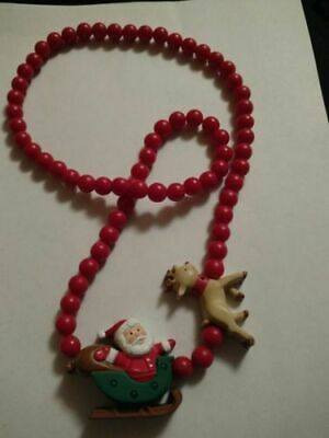 hallmark-cards-christmas-necklace-santa-and-reindeer-lights-up