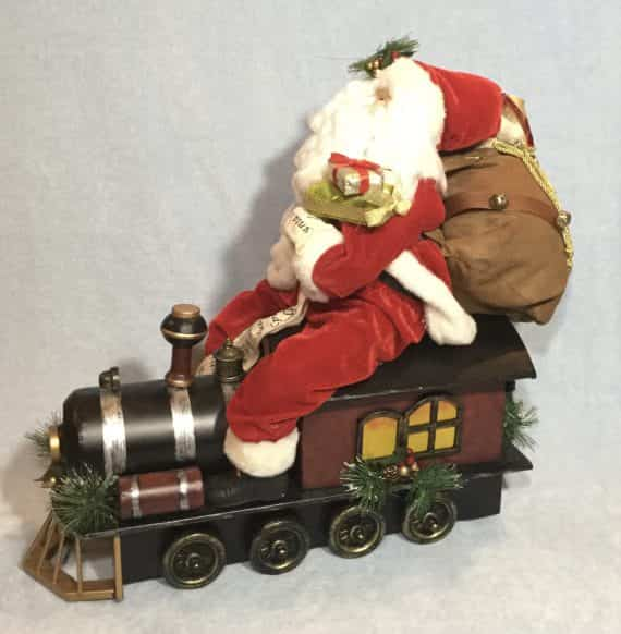 santa-riding-a-metal-rolling-train-santa-express